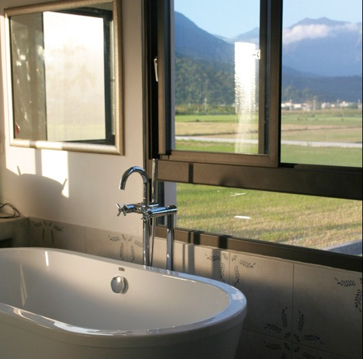 A little bit of luxury; a bathtub looks across the fields at the Central Mountain Range.