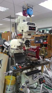 TAS's robotics labs include machinery for metal working.