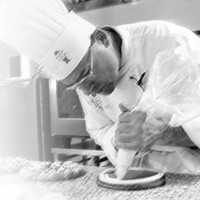 A Chef prepares a pastry