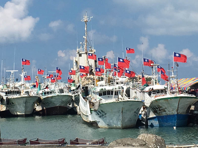 FLOTTILA — A fleet of fishing boats docked at Taiping Island on July 25 to assert Taiwan's sovereignty over the island and its surrounding waters. (Photo: CNA)