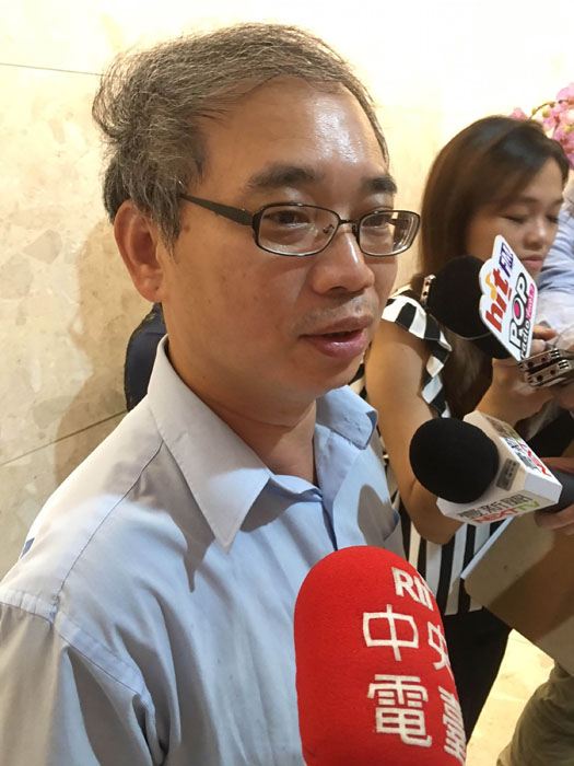 MOEA Investment Commission Executive Secretary Emile Chang talks to the press about the CNS case. Photo: CNA