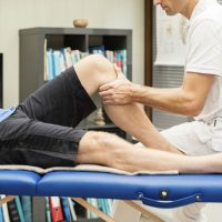 Performing the anterior drawer test in left knee